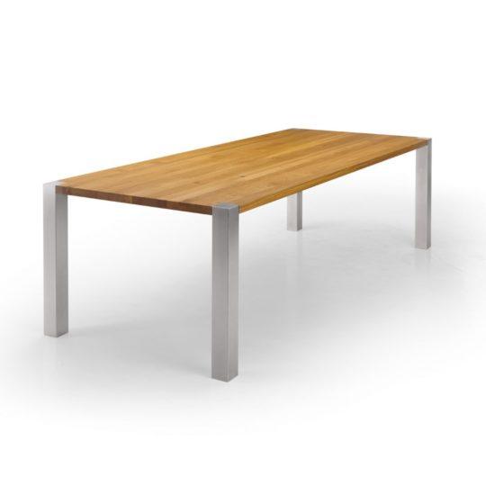 Massivholz Tisch mit Edelstahlgestell seitlich fotografiert